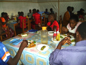 orphans eating a meal in Malawi because of my gift